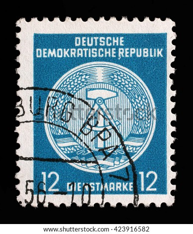 ZAGREB, CROATIA - SEPTEMBER 13: A Stamp printed in GDR (German Democratic Republic) shows GDR coat of arms, series GDRs national coat of arms, circa 1952, on September 13, 2014, Zagreb, Croatia - stock photo