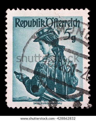 ZAGREB, CROATIA - SEPTEMBER 13: a stamp printed in the Austria shows Woman from Salzburg, Pinzgau, Regional Costume, circa 1949, on September 13, 2014, Zagreb, Croatia - stock photo
