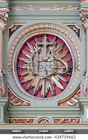 ZAGREB, CROATIA - SEPTEMBER 14: IHS sign on the altar in the Basilica of the Sacred Heart of Jesus in Zagreb, Croatia on September 14, 2015