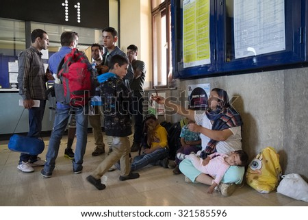 ZAGREB, CROATIA: SEPTEMBER 18, 2015: Immigrants and refugees from Middle East at train station building. - stock photo