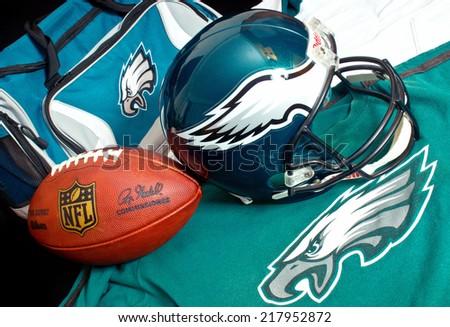 ZAGREB , CROATIA - SEPTEMBER 17 , 2014 :  NFL Philadelphia Eagles club equipment , ball, helmet, jersey and bag, product shot - stock photo