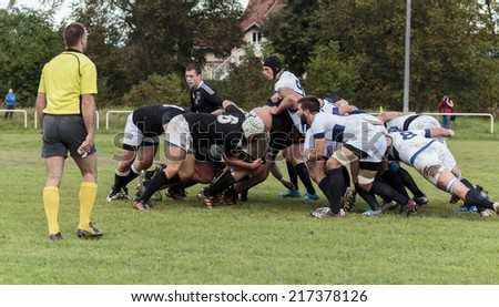 ZAGREB, CROATIA - SEPTEMBER 13, 2014: Rugby match Rugby Club Zagreb in white jersey and Rugby Club Sinj in black jersey. Unidentified player's tackle each other