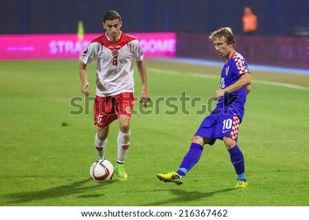 ZAGREB, CROATIA - SEPTEMBER 9, 2014: UEFA European Championship 2016 qualifiers in Group H - Croatia VS Malta. Ryan FENECH (6) and Luka MODRIC (10).  - stock photo