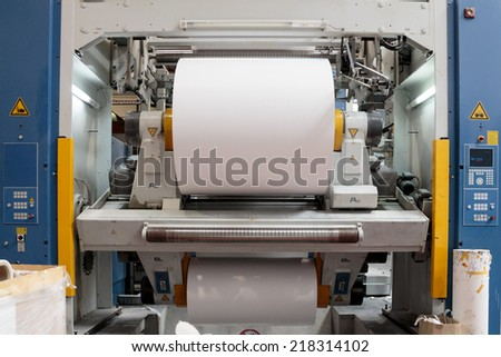 ZAGREB, CROATIA - SEPTEMBER 16, 2014: View of rotation Koenig Bauer machine in Printing house. Part of machine that is called the star, it changes rolls of paper continuously. - stock photo