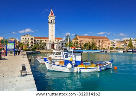 ZAKINTHOS, GREECE - AUG 22, 2015: Marina with boats on the bay of of Zante town on Zakynthos island, Greece. Zakynthos city called Zante town is a capital and biggest city of this small greek island. - stock photo