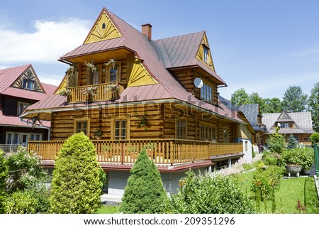 ZAKOPANE, POLAND - JULY 13, 2014: Residential building, wooden villa built in the style of the regional architecture in the first quarter of the 20th century