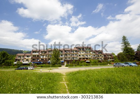 ZAKOPANE, POLAND - JUNE 11, 2015: Housing estate along the street Stolarczyk, residential buildings complex , architectural style for the city and the region were often built in the 20th century - stock photo
