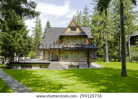 ZAKOPANE, POLAND - JUNE 10, 2015: Residential house built of wood probably in the first half of the twentieth century, has all the characteristics of Zakopane architectural style of those times - stock photo