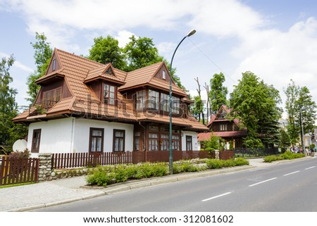 ZAKOPANE, POLAND - JUNE 20, 2015: The villa built of wood then plastered called Zegleniowka, built approx. 1923, listed in the municipal register of architectural heritage - stock photo