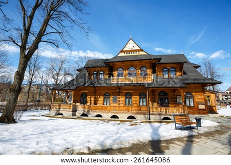 ZAKOPANE, POLAND - MARCH 10, 2015: Villa Jutrzenka built in the style of Zakopane in 1900, nowadays the seat of Tatra Culture and Sport Centre, Gallery Art-Park and Art Museum