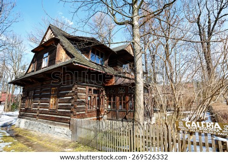 ZAKOPANE, POLAND - MARCH 10, 2015: Wooden residential building dates from 1897, was owned by a well-known doctor Waclaw-Kraszewski since 1912., Gallery of Modern Art since 1993 - stock photo