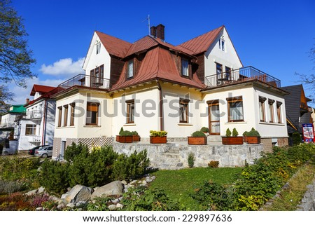 ZAKOPANE, POLAND - OCTOBER 14, 2014: Holiday House called Skalnica, formerly Mirabella, building of 1929, the regional style of architecture, offers 10 guestrooms