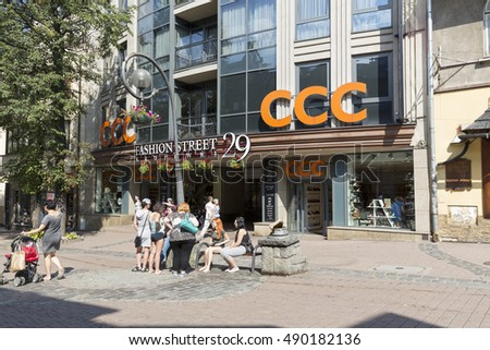 ZAKOPANE, POLAND - SEPTEMBER 12, 2016: Gateway to Fashion Street, avenue of boutiques of the world's top brands. The main entrance can be seen from Krupowki Street