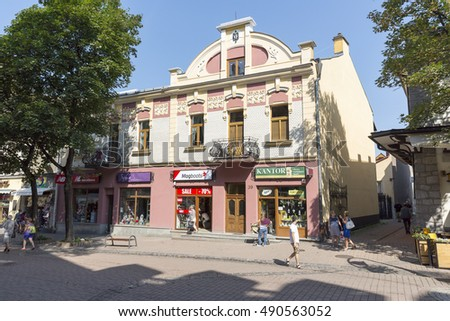 ZAKOPANE, POLAND - SEPTEMBER 12, 2016: Townhouse that is named Dom Mangla, was built in 1904 by a Jewish merchant Maks Mangel. The house is located by the Krupowki street in the downtown