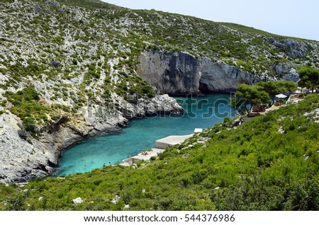 ZAKYNTHOS, GREECE, MAY 30: Unidentified people in Porto Limionas, preferred place for swimming and relaxing on the Ionian island, on May 30, 2016 in Zakynthos, Greece
