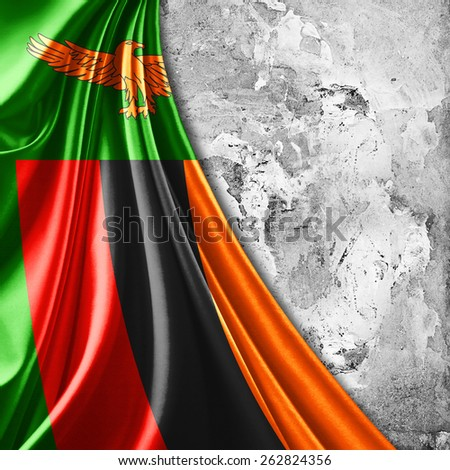 Zambia flag and wall background - stock photo