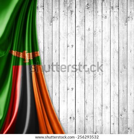 Zambia flag and wood background - stock photo