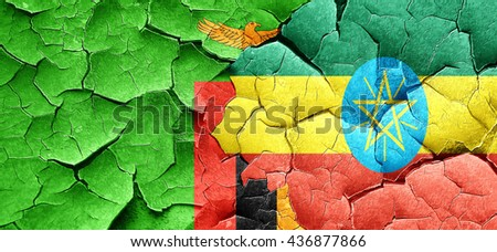 Zambia flag with Ethiopia flag on a grunge cracked wall - stock photo