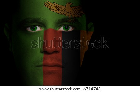 Zambian flag painted/projected onto a man's face