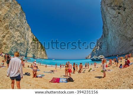 ZANTE ISLAND, GREECE - CIRCA JUNE 2015: Tourists taking selfie shots and enjoying Navagio Bay with Pirate's Shipwreck - stock photo