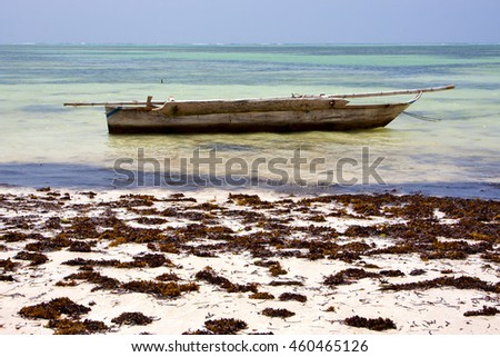 Zanzibar Africa coastline boat in the  blue lagoon