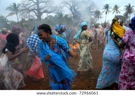 ZANZIBAR, TANZANIA - JULY 20: Women at a traditional feast on JULY 20, 2009 in Zanzibar, Tanzania. Every year in Zanzibar there is a traditional African feast festival in honor of the fishermen. - stock photo