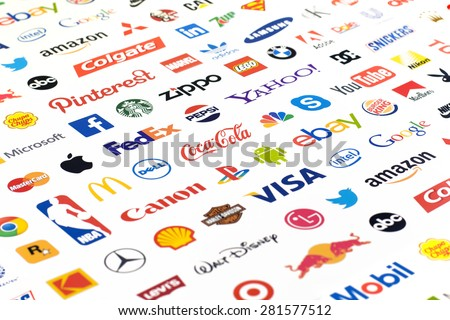 ZAPOROZHYE, UKRAINE - MAY 26, 2015: Photo of a logotype collection of well-known world brand's printed on paper. Include Coca-Cola, Canon, McDonald's, Twitter, Apple and more others logo. - stock photo