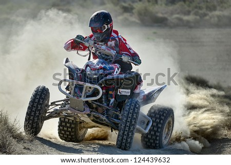 Zaragoza, SPAIN - JUL 21 : Maxime Albira and his Honda TRX 700, races in Baja Spain, on Jul 21, 2012 in Zaragoza, Spain - stock photo