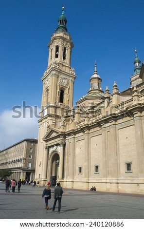ZARAGOZA, SPAIN, NOVEMBER 1, 2014: People are walking through plaza del pilar in spanish city zaragoza, which is famous also for its basilica del pilar.