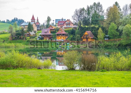 Zawoz - small village on Solina lake shore (Bieszczady mountains, Poland), in the beginning of May - stock photo