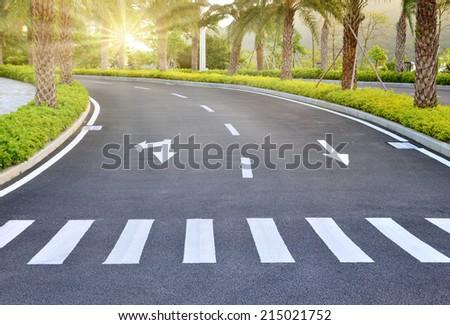 Zebra way on the asphalt road surface - stock photo