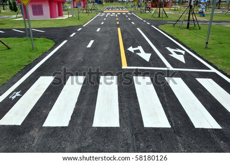 zebra way on the asphalt road surface - stock photo