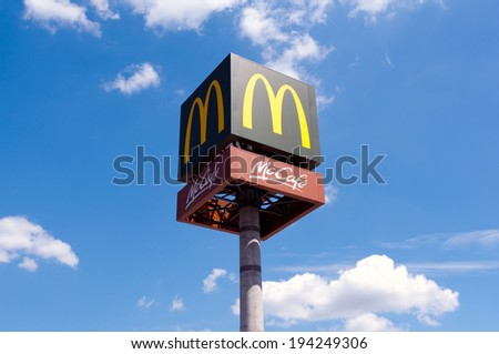 Zegrze, Poland - MAY 20: AN New emblem of McDonalds McCafe on blue sky, on construction at Poland on May 20 2014. McDonald's Corporation is the largest of fastfood restaurants. - stock photo