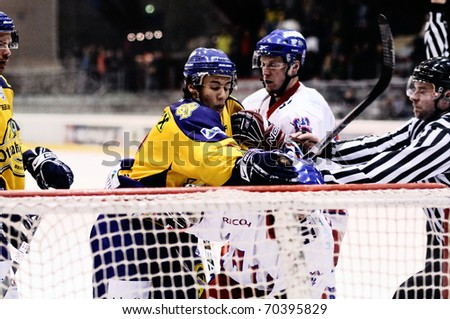 ZELL AM SEE, AUSTRIA - FEB 1: Austrian National League. Putnik punches Graz player. Game EK Zell am See vs. ATSE Graz (Result 4-1) on February 1, 2011, at hockey rink of Zell am See - stock photo