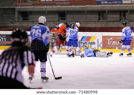 ZELL AM SEE, AUSTRIA - FEB 13: Salzburg hockey League. Fight between Enzenbrunner and Morzg player. Game SV Schuttdorf vs HCS Morzg  (Result 9-3) on February 13, 2011 at the hockey rink of Zell am See - stock photo