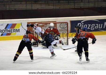 ZELL AM SEE, AUSTRIA - NOVEMBER 28: Salzburg hockey League. Thorsten Scharer tripping attacking Devils player. Game SV Schuettdorf vs Devils Salzburg (Result 2-13) on November 28, 2010, in Zell am See, Austria - stock photo
