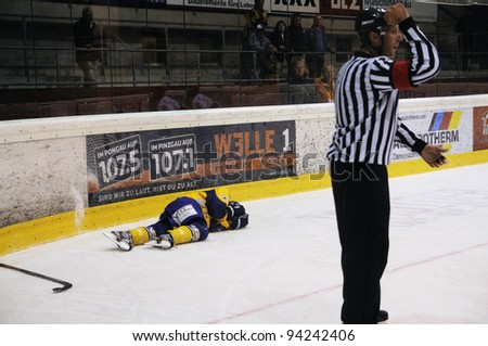 ZELL AM SEE; AUSTRIA - OCT 2: Austrian National League. A Player of EK Zell am See got hurt during the game. Game between EK Zell am See and ATSE Graz (Result 2-3) on October 2, 2011 in Zell am See - stock photo