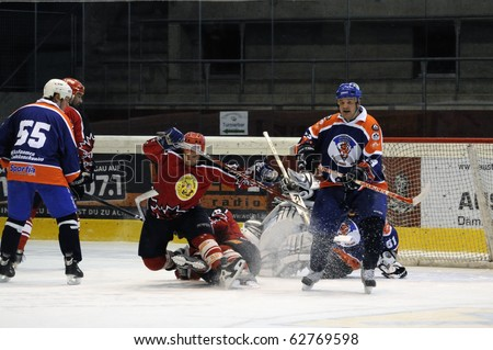 ZELL AM SEE, AUSTRIA - SEPTEMBER 30: Austrian Icehockey Classic Tournament. Action in front of Pallojussit keeper. Game Zell am See Oldies vs. Pallojussit (3-3) on September 30, 2010 in Zell am See, Austria. - stock photo