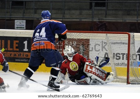 ZELL AM SEE, AUSTRIA - SEPTEMBER 30: Austrian Icehockey Classic Tournament. Action in front of Goalie Hochwimmer. Game Zell am See Oldies vs. Pallojussit (Result 3-3) September 30, 2010 in Zell am See, Austria. - stock photo