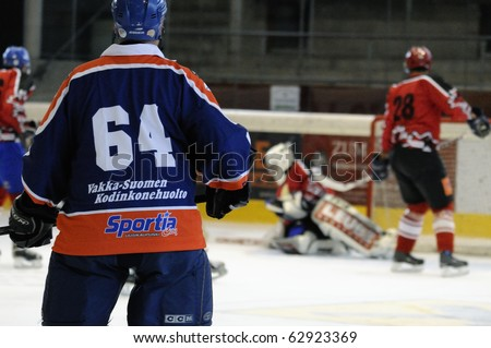 ZELL AM SEE, AUSTRIA - SEPTEMBER 30: Austrian Icehockey Classic Tournament. Action in front of Goalie Hochwimmer. Game Zell am See Oldies vs. Pallojussit (3-3) on September 30, 2010 in Zell am See - stock photo