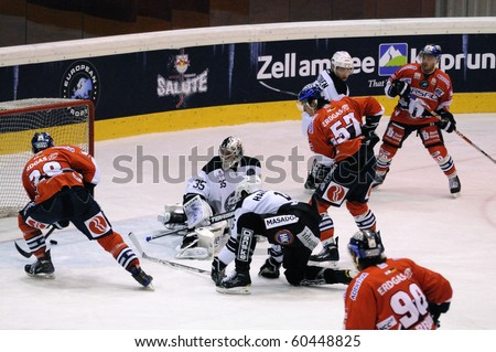 ZELL AM SEE; AUSTRIA - SEPTEMBER 3: Red Bull Salute Tournament. Scoring chance for Berlin in the second period. Game TPS Turku vs. Eisbaeren Berlin  (Result 1-4) on September 3, 2010 in Zell am See. - stock photo