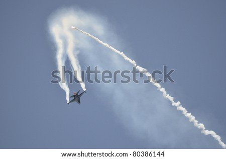 ZELTWEG, AUSTRIA - JULY 01: display of a General Dynamics F-16 Fighting Falcon from Belgian air force by airshow - airpower11 - on July 01, 2011 in Zeltweg, Austria