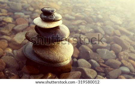 Zen Balance Rocks Pebbles Covered Water Concept - stock photo