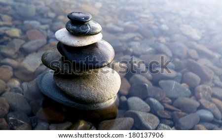 Zen Balancing Rocks on Pebbles Covered With Water - stock photo