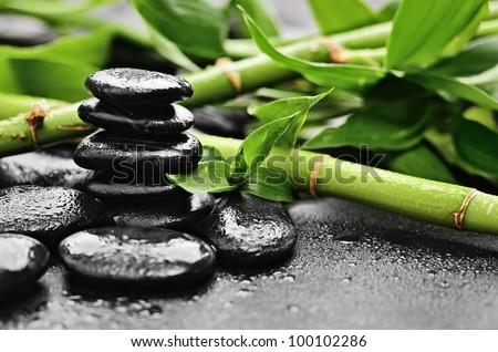 zen basalt stones and bamboo with dew - stock photo
