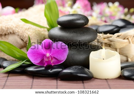 zen basalt stones and orchid on the wooden mat