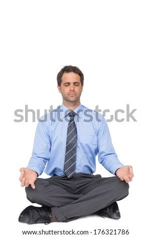 Zen businessman meditating in lotus pose on white background - stock photo