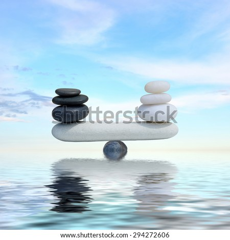 Zen concept background-The balance between the black and white zen stones - stock photo