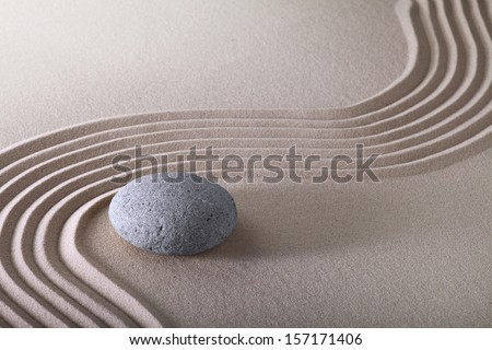 zen garden japanese garden zen stone with raked sand and round stone tranquility and balance ripples sand pattern - stock photo