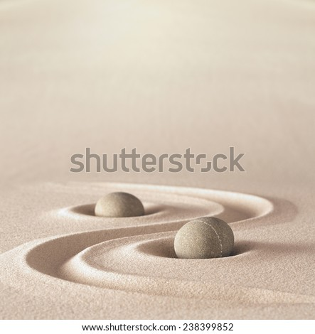 zen garden meditation stone background with copy space stones and lines in sand for relaxation balance and harmony spirituality or spa wellness - stock photo